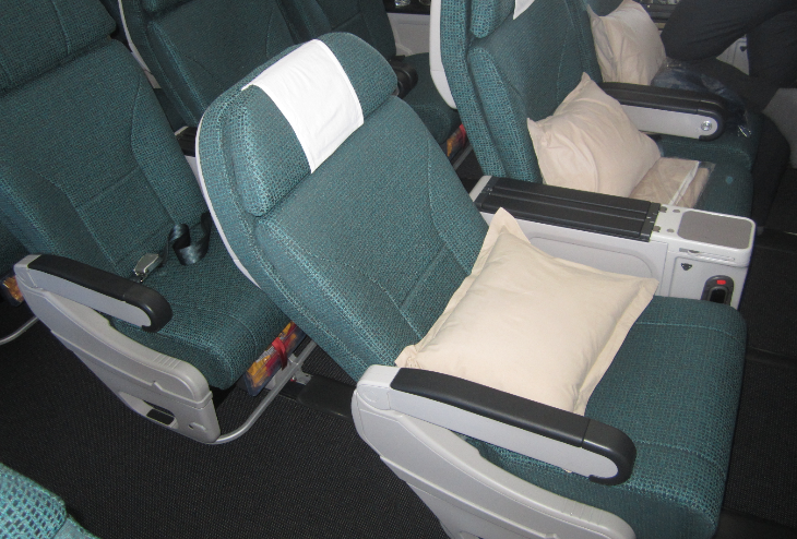 Cathay's premium economy seats are located in a small, intimate section behind business class (Photo: Ramsey Qubein)