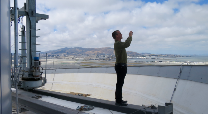 Your excited TravelSkills editor Chris McGinnis capturing a moment on the top of SFO control tower (Doug Yakel)