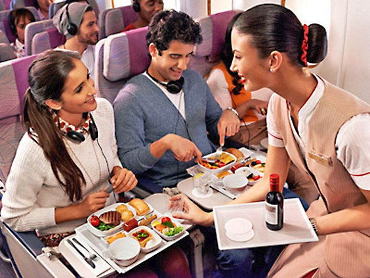Meal service in Emirates economy class. (Image: Emirates)