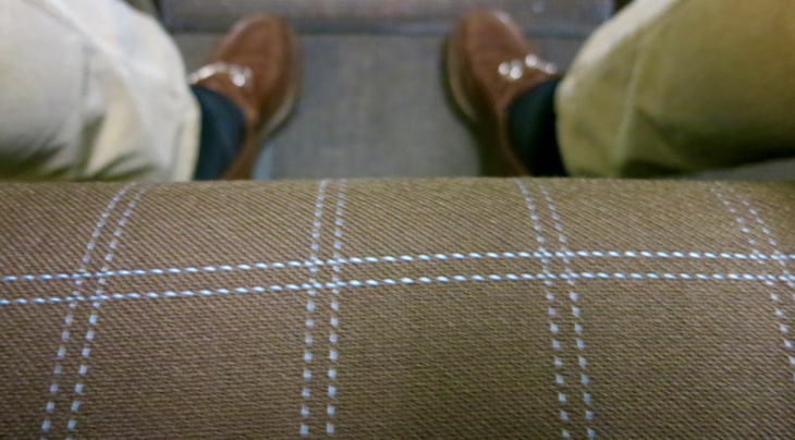Business class seats are dark brown with pleasant pale blue stitching (Chris McGinnis)