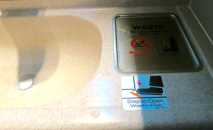 Nifty, hygienic pedal opens waste bin in lavatory on Singapore Air (Chris McGinnis)