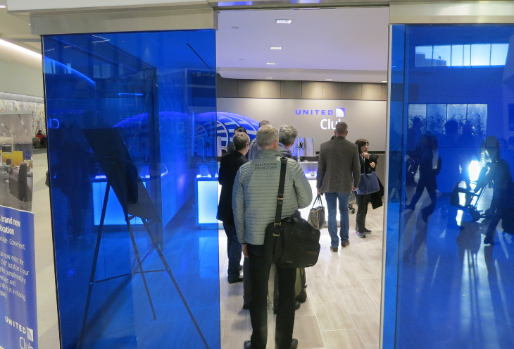 Big blue glass doors at the entry to United's brand new Club (Chris McGinnis)