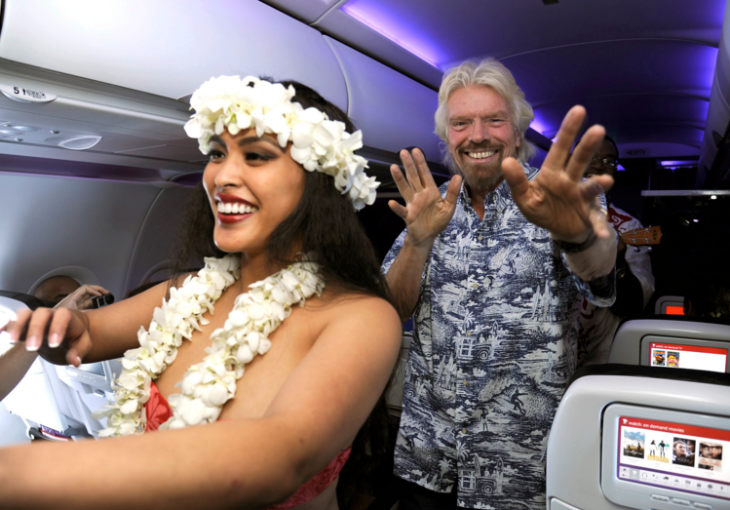 Richard Branson fooling around on Virgin's inaugural flight to Honolulu in November (Photo: Virgin America)