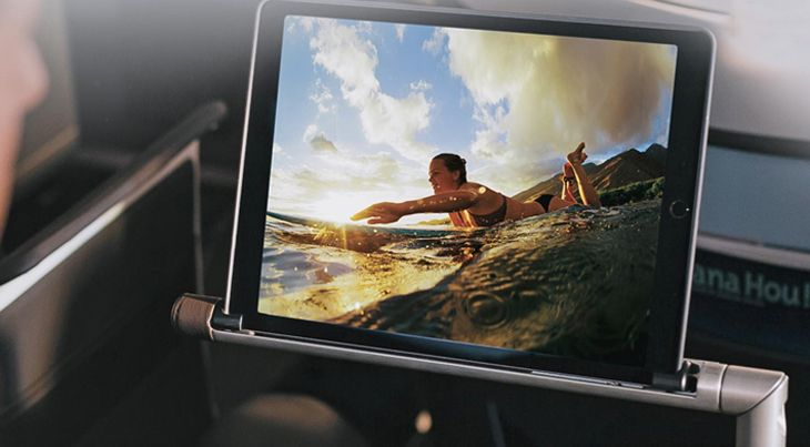 In-flight entertainment can be seen on tablets that rest on an adjustable arm. (Image: Hawaiian)