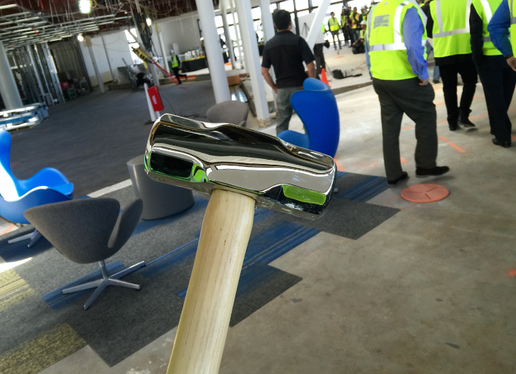 Instead of shovels, dignitaries used sledgehammers at SFO event. Interim terminal construction in background (Chris McGinnis)