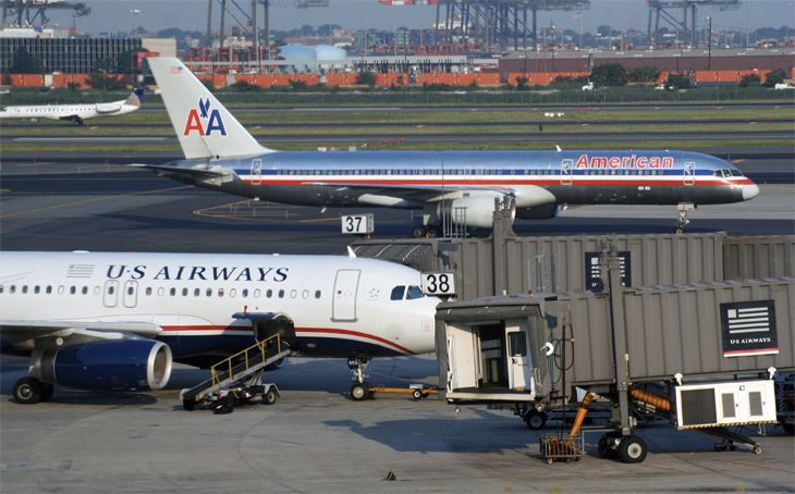 DOJ forced American and US Airways to give up slots at key airports to win merger approval. )Image: Jim Glab)