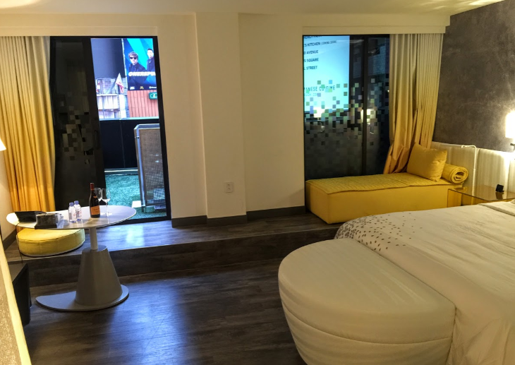 A big bright white & yellow room with terrace overlooking Times Square (Chris McGinnis)