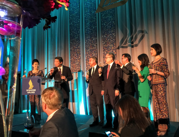 Singapore Airlines execs, Singapore's ambassador to the US, local media and Singapore girls on stage at the St Regis (Chris McGinnis)