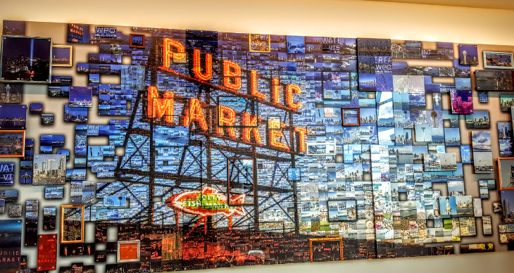Pixelated mural of Pike Place Market by artist Craig Alan McMillan, the same artist who did the Golden Gate Bridge mural at the SFO Sky Club (Photo Scott Hintz)