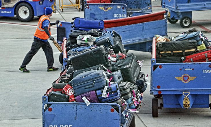 Airlines keep raking in more fee on checked bags. (Image: Jim Glab)